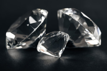 selective focus of clear diamonds on black background