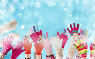 children gloves and winter snow background with snowflakes
