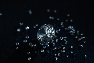 big and small clear diamonds isolated on black