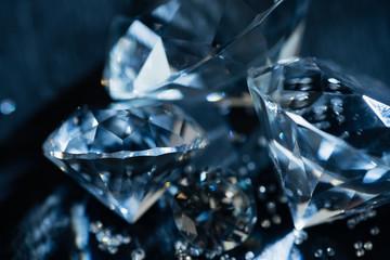 close up of transparent pure diamonds on black background
