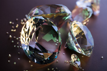 selective focus of pure diamonds on brown background