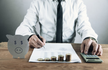 Man using calculator while working for financial document. Business concept