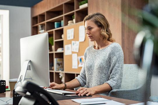 Creative business woman using computer