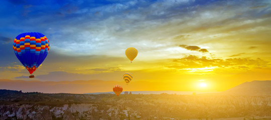 Hot air balloons sunset horizon