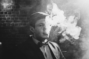 Retro portrait of a man smoking hookah. black and white view