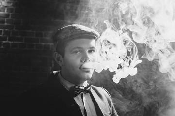 Retro portrait of a man smoking hookah. black and white view