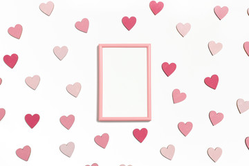Photo frame mock up. Pattern made of colorful hearts on a white background