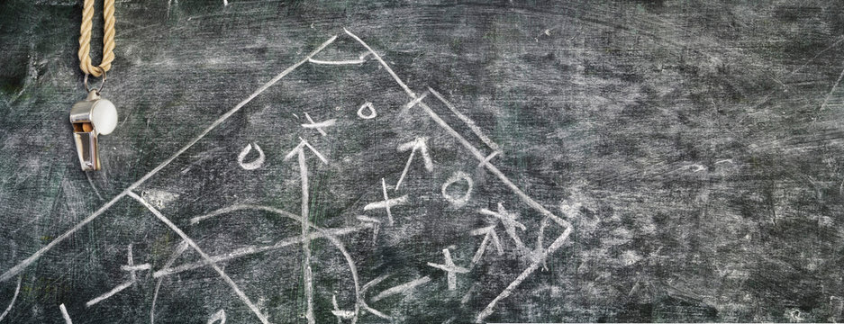 whistle of a soccer referee or trainer on blackboard w.strategy diagram scribble panoramic, free copy space