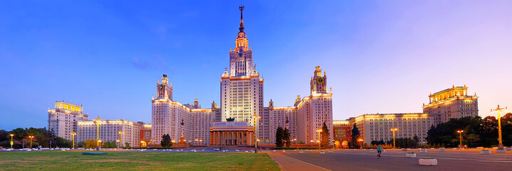 Wide angle vibrant panoramic evening view of nicely illuminated famous Russian university