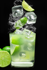 Brazilian caipirinha splash in black background