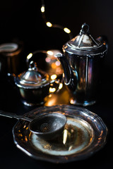 silver dishes on a black background - vintage