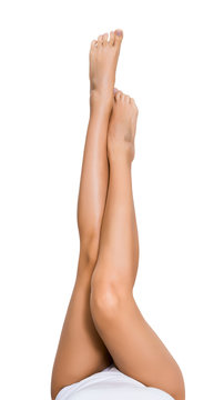 Beautiful woman lifting her legs up in air