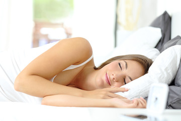 Single girl sleeping comfortable on a bed