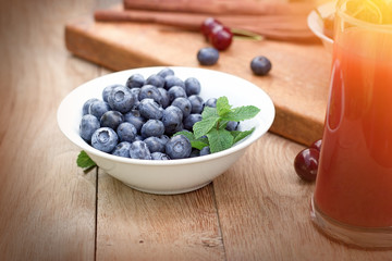 Blueberry - blue berries in bowl on rustic table, healthy organic food
