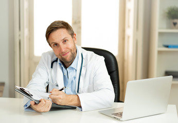 Portrait of successful specialist doctor working in hospital office looking happy and confident