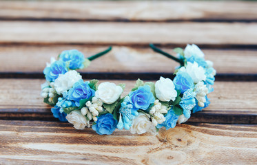Handmade hoop blue and white flowers. Blue and white hair band on wooden background