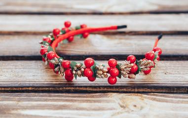 Handmade hoop Red  flowers. Red berries hair band on wooden background