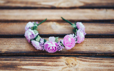 Handmade hoop purple flowers. Red and white hair band on wooden background