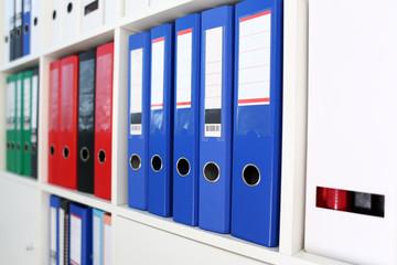 Book shelf full of file folder in office closeup