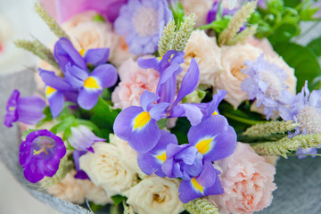 Purple irises and other flowers in the bouquet.