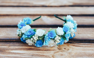 Handmade hoop blue flowers. Blue hair band on wooden background