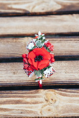 Handmade hoop flowers. Red poppies hair band on wooden background. Ukrainian style. Ukrainian ornament. Top view