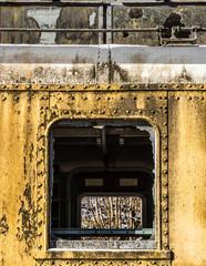 Wagon. Rusty. Abandoned. Damage. Window. Ruined