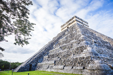 The Kukulkan pyramid construction left view in Chichen Itza on the Yucatan peninsula
