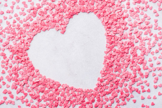 Valentine's day heart shaped frame background made of candies.