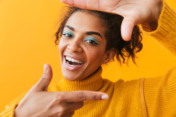 Cheerful young african woman wearing sweater
