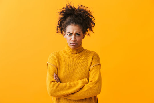 Upset young african woman wearing sweater