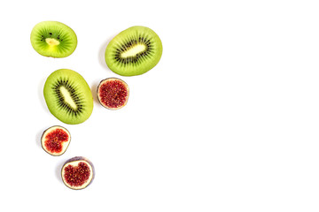Sliced fruits. Slices of juicy green kiwi and red figs. Isolated on white.
