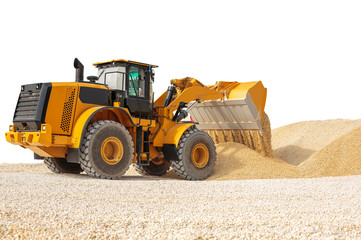 Working bulldozer on a building site isolated with clipping path. Modern wheel loader.