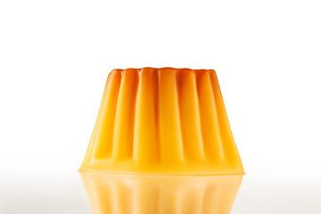 Juicy udding or creme caramel isolated over white background.