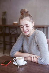 Girl drinking coffee in a restaurant
