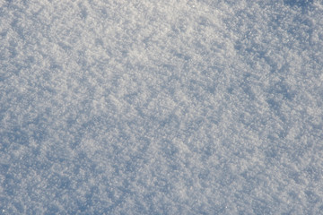 the natural background - snow surface in beams of the sun