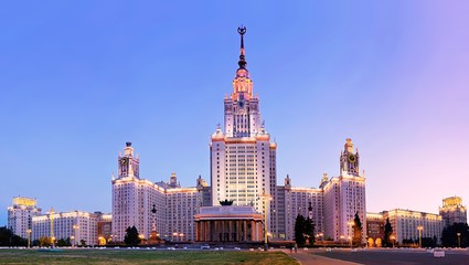 Vibrant wide angle panoramic evening view of illuminated famous Russian university in summer