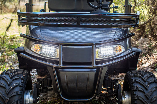 front of gold cart atv all terrain utility vehicle