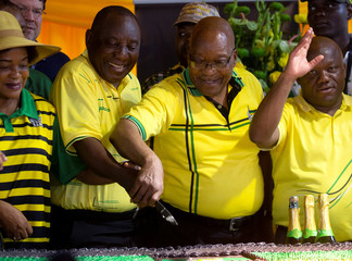 South African President Cyril Ramaphosa and former President Jacob Zuma cut a cake celebrating the 107th anniversary of the African National Congress in Durban