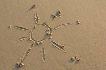 Sun drawn in sand, close up