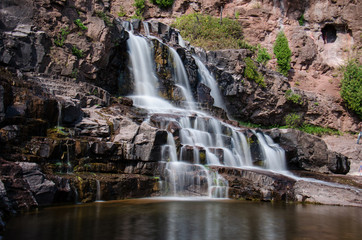 Daytime long exposure of Gooseberry Falls waterfalls at the state park in Minnesota in summer