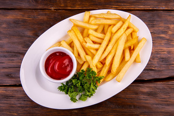 The fried French fries with ketchup
