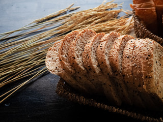 Fresh baked bread in basket,put at the right side of wooden desk