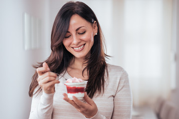 Beautiful woman with creamy dessert.