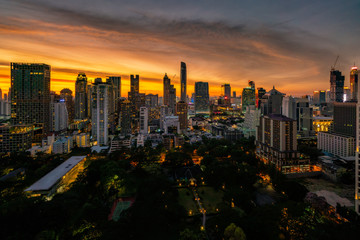 Fototapete - Aerial view of Bangkok skyline and skyscraper with sunset sky on Sukhumvit road center of business in Bangkok city downtown Thailand.