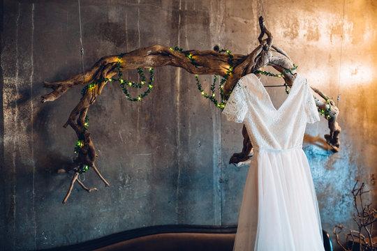 Wedding dress on a hanger in the loft