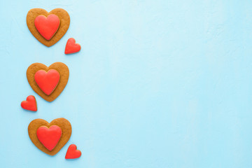 Red heart shaped cookies on blue background. Valentine's Day.