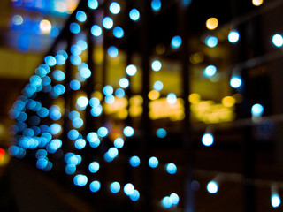 Blurred background of street bar night with light bokeh abstract