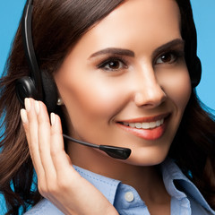 Customer support phone operator in headset, on blue
