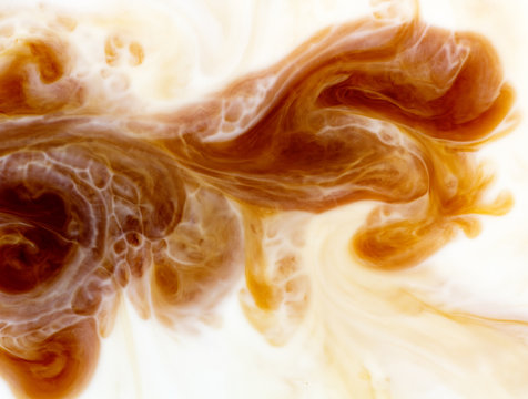 abstract background mixing coffee with milk flow